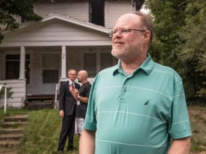 """Battle Creek resident Rick McNally lives next to the blighted property at 84 Riverview Ave. McNally said he remembers the fire that tore through the home in 2013 and he """"can't wait"""" for it to be demolished by the Calhoun County Land Bank Authority."""